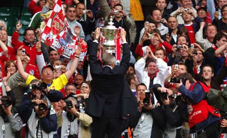 Arsene Wenger with the FA Cup