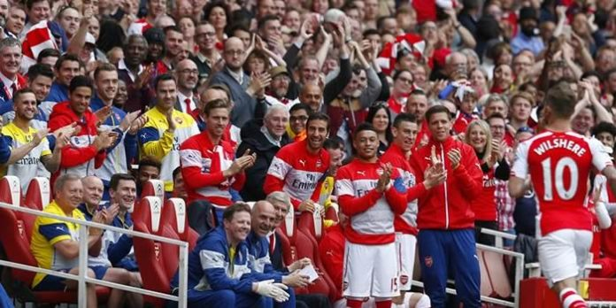Jack Wilshere runs to the bench after his goal against West Brom